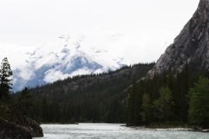 a-river-runs-through-the-mountains-in-banff-ab